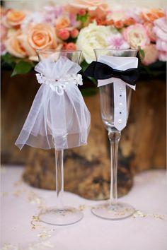 bride and groom champagne glasses #champagne #brideandgroom #weddingchicks http://www.weddingchicks.com/2014/02/27/sophisticated-stable-wedding/