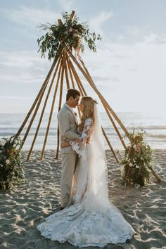 Tori and Niko's dreamy California beach wedding at Levyland Estates has us longing for warmer weather, sand between our toes, and picturesque sunsets. The couple created a vintage boho vibe by setting up a teepee-inspired arch for the ceremony and using a mix of antique and handmade decor. See all the stunning details here: http://junebugweddings.com/wedding-blog/breezy-cream-and-beige-beach-wedding-at-levyland-estates/