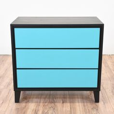 This retro chest of drawers is featured in a solid wood painted in a bold and vibrant aqua blue and black paint. This small mid century modern dresser is in great condition with 3 drawers and a minimalist sleek design. Perfect as an end table!   #midcenturymodern #dressers #shortdresser #sandiegovintage #vintagefurniture