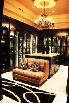 Large walk in closet-Dressing Room, masculine colors, dim lighting, dark wood, leather seating
