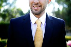 Groomsmen and groom's suit and tie: Navy Blue suit and gold tie