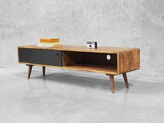 This TV stand, stand out! its wide horizontal appearance would be great for making a TV look wider.
