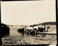 Sepia Photo by DeGroom of boating family.
