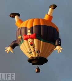 fly in a hot air balloon. and if it's in the shape of humpty dumpty, EVEN BETTER.(a bit creepy though!)