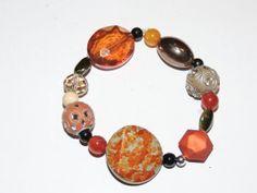 Handmade beaded bracelet.  Has large amber by GabiLuBoutique, $23.00