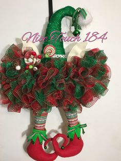 Cute elf hat wreath with legs to add a little whimsy to your Christmas decor. Christmas Mesh Wreaths, Diy Fall Wreath, Christmas Tree Farm, Christmas Hat, Wreath Crafts, Christmas Projects, Christmas Crafts, Christmas Decorations, Christmas Ornaments