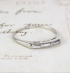 Triple Baguette Wedding Band 14k wg $700, cannot be resized