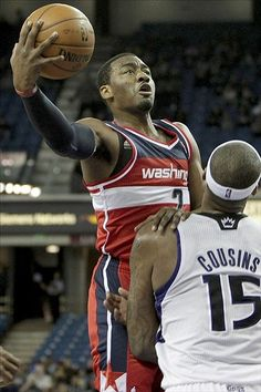 John Wall lay up over Demarcus Cousins!