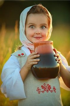 """Tasty Milk"". A Russian girl in a traditional kerchief and an embroidered sarafan (a kind of a sleevless dress). #cute #kids #Russian #folk"
