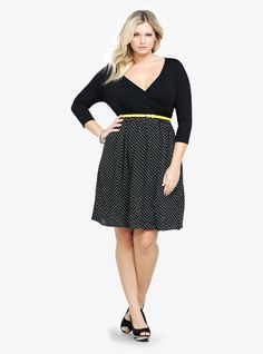 A polka dotted challis skirt - shirred for playful movement - mixes it up with a knit top on this flirty dress. Did we mention the oh-so-sexy surplice neckline and skirt pockets?