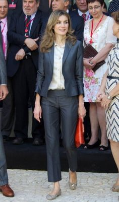 Princess Letizia wears a perfectly tailored navy suit with ballet flats.