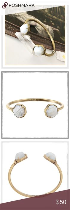 "✨Kendra Scott Brinkley White Banded Agate Cuff✨ ✨Kendra Scott Brinkley White Banded Agate Pinch Cuff Bracelet✨From the Kendra Scott Fall 2016 collection, this Brinkley bracelet style features a cuff design with two white banded agate gemstones✨Crafted in antique plated brass, this cuff looks stunning layered with other bracelets or worn alone✨With its easy to match palette, it will pair perfectly with everything✨This cuff is 2.25 inches in diameter and the gemstone stations are .563"" in…"