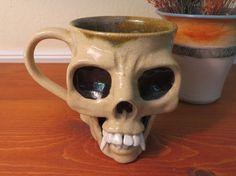 A personal favorite from my Etsy shop https://www.etsy.com/listing/457397730/stoneware-pottery-skull-mug-coffee-mug