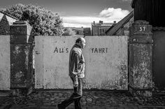 #EXIT by Arno Simons #Photocircle #photoart from #Germany #MeckPomm #monochrome #bw #blackandwhite #peoplephotography #streetphotography #street #oldman #solitude #loneliness #summer  #Closethecircle - if you buy this photo Arno Simons and Photocircle #donate 16% to help people affected by the war in #Syria - #socent #dogood #purchasewithpurpose #giftsthatgiveback #wallart #homedecor