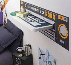 Music decor...floating cassette tape shelf.. and speaker bedside table.. and look at the cd glass plate.. very nice
