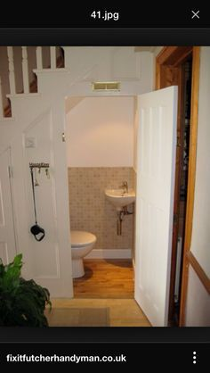 Small Bathroom Design Under Stairs here is a good example of a modern bathroom below a staircase