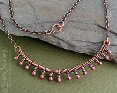 copper necklace wire wrapped with rosy copper buds.