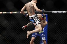 Dustin Poirier receives a flying knee from Max Holloway at UFC 143 on Feb. 4, 2012 in Las Vegas.
