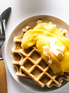 Dairy free coconut waffles with mango. Made with a double dose of coconut milk and coconut oil. Light and crisp, perfect for a springtime brunch.