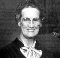 """Lois Roden, an anti-patriarchal reformer of the Seventh Day Adventist theology.  She was apparently unlike him, but she was the """"guru"""" of David Koresh, with whom, in her 70s, she is believed to have had an affair.  He inherited his institutional role from her."""