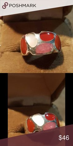 Vintage Sterling Silver Inlay Red Coral Ring Vintage Sterling Silver Inlay Red Coral, Angel Skin Coral & Mother of Pearl Band Style Ring size 6.5. Marked MK 925 & tested. Stunning. And a Perfect Holiday Ring. Band Tappers Nicely. Very Well made. Great Condition. Jewelry Rings