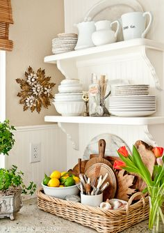 Open cottage kitchen shelves, Basket tray for corralling small items. Anti-clutter secret: put all your little things on a bigger tray and they suddenly look less chaotic.