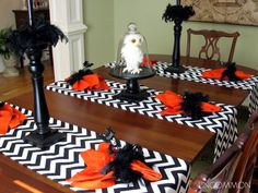 I like the chevron print on the table runners and the contrast with the orange.