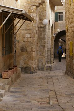 """The old city of Jerusalem really is a city of stone. In all the wandering I did in that ancient 225 acre compound the only green I saw besides in planters was up on the Temple Mount by the Dome of the Rock.    The """"streets are seldom more than 15 feet or so wide and slope on either side toward the middle for water drainage. Israel."""