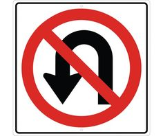This is a No U-turn sign. Whenever you see this, you are not supposed to do a u-turn in the middle of the road. This is a low cognitive effort.