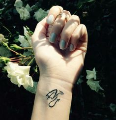 Minimalist dragon wrist tattoo// I would love this on the back of the neck