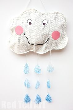 Bubble Wrap Printing - happy rain cloud mobile - using recycled materials to make this happy mobile. Rain rain go away......
