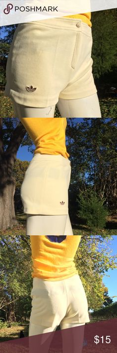 """vintage 1980s Adidas tennis shorts good vintage condition. Cream/ Off white/Light yellow 100% polly. Vintage size 10 Measures approx 14"""" flat, across, unstretched.  Hips approx 17.5"""" Waist to hem 11"""" Inseam is 2"""" Rise is 10.5"""" Zipper and logo button closure (the black strips u might see through the shorts is tape to keep my mannequin together)  Thank you Adidas Shorts"""