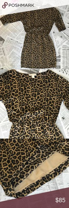 "Michael Kors Leopard Print Dress Gorgeous dress in leopard print, elastic waistline and 3/4 sleeve. Feels almost like silk! Perfect condition!  Size: S 100% Polyester  Non Smoking Home  Approx Measurements: Arm length: 3/4 Shoulder to hem: 37"" Michael Kors Dresses"