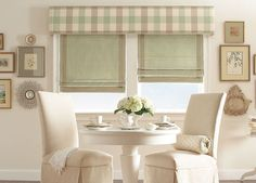 Dress up bare windows with a Roman shades featuring a decorative trim and a straight cornice. #BudgetBlinds
