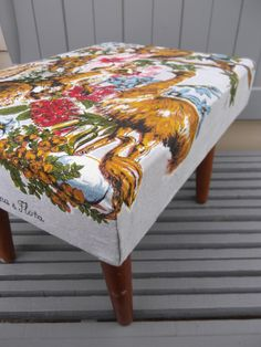 repurposed vintage tea towel - would need a table cloth to cover the ottoman...