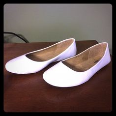 NEW white flats Soft material inside make them very comfy. Purchased all different colors since they were so comfortable but never ended up wearing the white or brown pair. Leather like material outside so easy to clean and keep white  Shoes Flats & Loafers