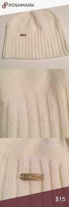 Calvin Klein Beanie Hat NWOT Never worn cream colored Calvin Klein beanie hat. It has a knit pattern with rib knit trim and a logo plaque. It is so cute on! Calvin Klein Accessories Hats