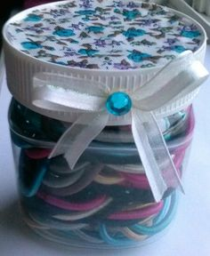 Repurpose your nutella jar! Cut a circle out of some fabric or decorative paper, glue it to the top with hot glue, mod podge, or spray glue. Add a ribbon and use your pretty jar for storage. Great for q-tips, cotton balls or scrunchies.
