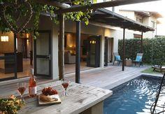 Nursery Lane: Wine by the pool.  FIREFLYvillas, Hermanus, 7200 @fireflyvillas ,bookings@fireflyvillas.com,  #NurseryLane  #FIREFLYvillas # HermanusAccommodation