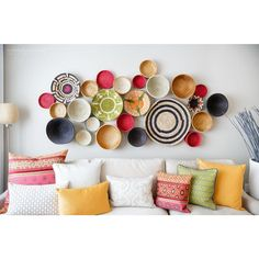 Colorful baskets on wall. Paint the insides. by Natalie Fuglestveit Interior Design Mediterranean Living Rooms, Empty Wall, Baskets On Wall, Woven Baskets, Painted Baskets, Hanging Baskets, Cane Baskets, Wall Basket, Blank Walls