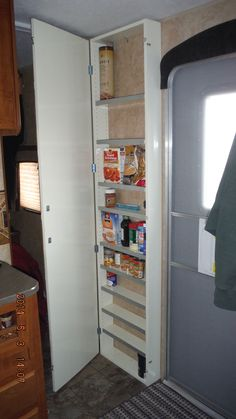 Installed a pantry cabinet today in some of the unused wall space of our trailer.  Excellent use for a wasted spot. http://rvhappyhour.com/forums/topic/new-pantry/