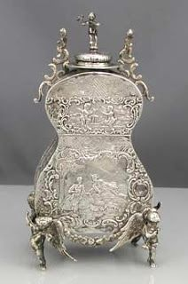 Silver tea caddy.  Wish I could find a better picture of this.