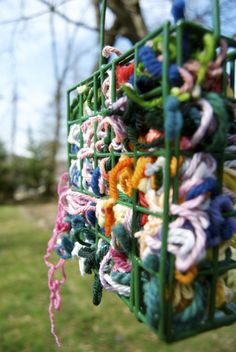 Place scraps of yarn in a suet feeder and birds will use them to make their nests. Place scraps of yarn in a suet feeder and birds will use them to make their nests. First Day Of Spring, Early Spring, Spring Time, Outdoor Fun, Outdoor Ideas, Bird Feeders, Bird Nests, Bird Suet, Bird Houses