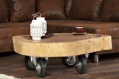 """Funktionalität, Individualität kombiniert mit einem faszinierenden, natürlichen Charme, so präsentiert sich der einzigartige Holztisch """"TRUNK"""". Die Form und die Maserung der Tischplatte lassen erkennen, dass dieser Tisch in einem Stück aus einem Baumstamm gefertigt wurde. Ausgestattet mit Rollen, lässt sich dieser Tisch kinderleicht verrücken und an jeden X beliebigen Ort positionieren."""