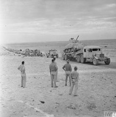 A long line of transport, including a Sherman tank on a Scammell tank transporter, moving along the coast road in pursuit of the enemy, 11 November Afrika Corps, North African Campaign, Ww2 Pictures, Ww2 Photos, Sherman Tank, Army Vehicles, Armored Vehicles, Armored Fighting Vehicle, Ww2 Tanks