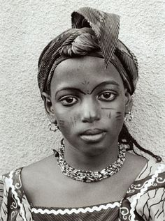 'Fulani Girl with Peaked Headgear' (2006) by American photographer Thomas Miller (b.1943). Gold-toned silver gelatin print, edition of 6, 12.625 x 9.375 in. via Augen Gallery