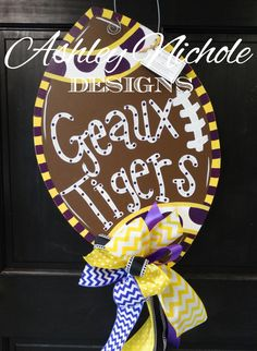 LSU Tigers Inspired Football Door Hanger, Door Decoration,  Fall Wreath, Wooden Football by DesignsAshleyNichole on Etsy https://www.etsy.com/listing/247017718/lsu-tigers-inspired-football-door-hanger