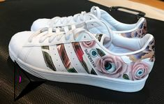 54801039b3 Custom Adidas superstar sneakers hand painted with roses with eyes in the  middle. Custom shoes. Etsy