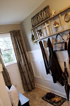 Love the old ladder that doubles as coat rack/frame.