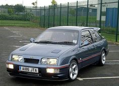 A perfect / Sierra Cosworth blend. Too bad there aren't many like this! Ford Sierra, Ford Rs, Car Ford, Bmw E36, Ford Taurus Sho, E36 Coupe, Ford Motorsport, Ford Capri, Old School Cars